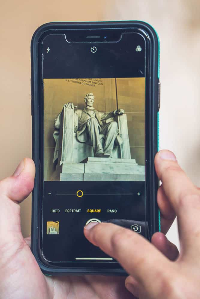 childfree travel: a cellphone taking a photo of the Lincoln memorial